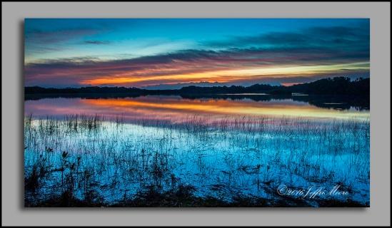 Sunrise at Nine Mile Pond by Jeffri Moore